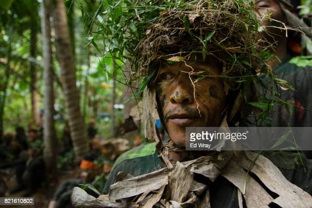 Banser recruit waits for his turn to cross a water obstacle during a rigorous three day induction course on July 23 2017 in Kebumen Indonesia Banser...