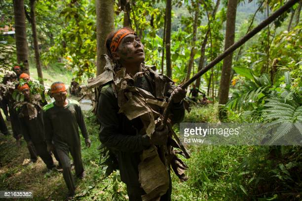 Banser recruit wearing camouflage prepares to climb a rope during a rigorous three day induction course on July 23 2017 in Kebumen Indonesia Banser...