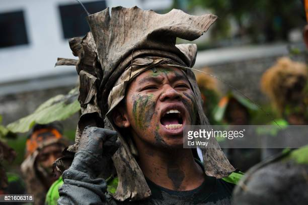 Banser recruit wearing camouflage shouts the Banser song before the start of the penultimate 5 hour run though an obstacle course during a rigorous...