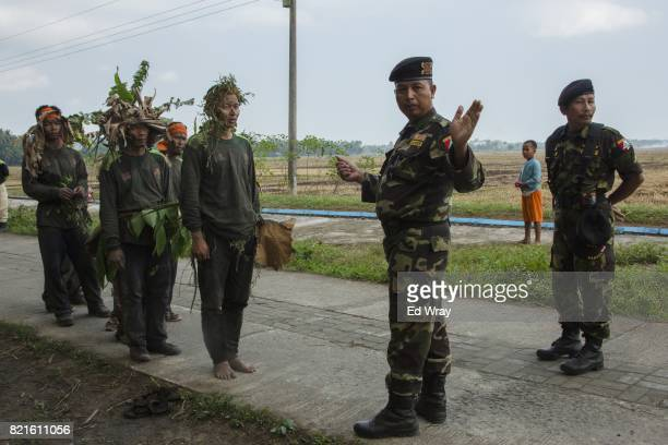 Banser recruits get instructions from a senior Banser officer during a rigorous three day induction course on July 23 2017 in Kebumen Indonesia...