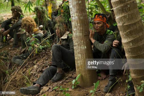 Banser recruits rest while on a long march during a rigorous three day induction course on July 23 2017 in Kebumen Indonesia Banser the security unit...