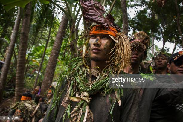Banser recruits wait their turn to cross a water obstacle during a rigorous three day induction course on July 23 2017 in Kebumen Indonesia Banser...