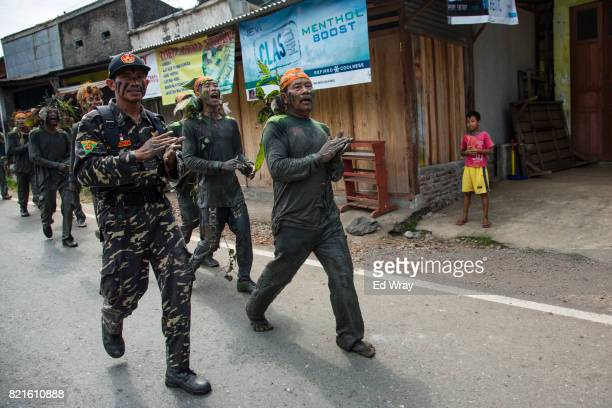Banser recruits walk through a town during a rigorous three day induction course on July 23 2017 in Kebumen Indonesia Banser the security unit of...