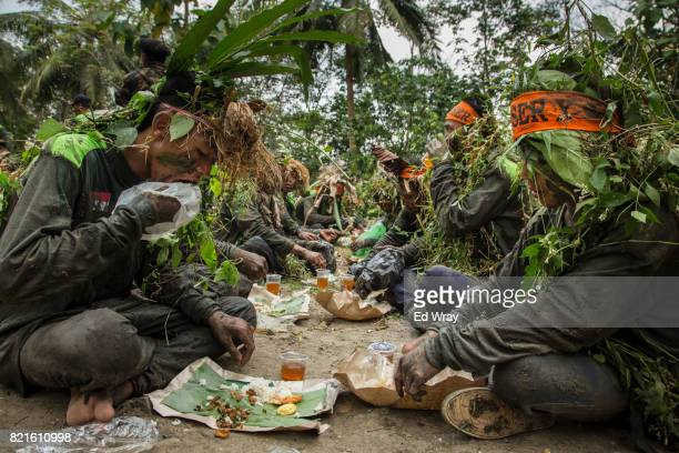 Banser recruits wearing camouflage eat lunch while on a long march during a three day induction course on July 23 2017 in Kebumen Indonesia Banser...