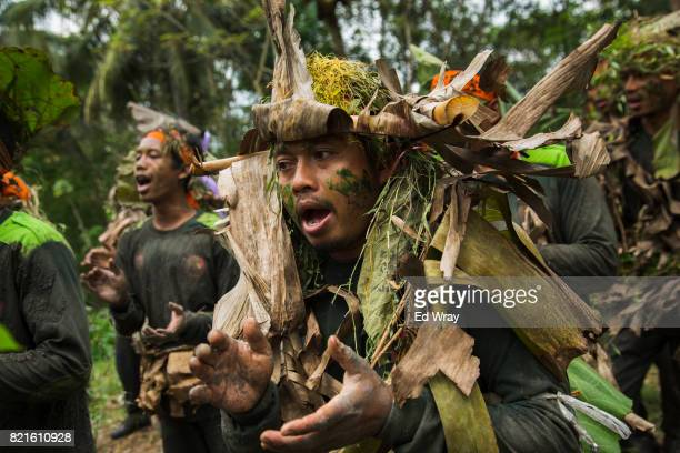 Banser recruits wearing camouflage sing while on a long march during a three day induction course on July 23 2017 in Kebumen Indonesia Banser the...