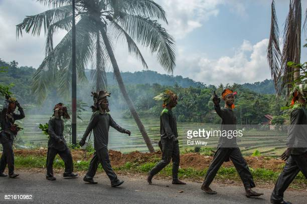 Banser recruits wearing camouflage walk along a road during a rigorous three day induction course on July 23 2017 in Kebumen Indonesia Banser the...