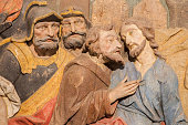 Banska Stiavnica -  The detail of carved relief of Betrayal of Judas as the part of baroque Calvary from years 1744 - 1751  by Dionyz Stanetti.