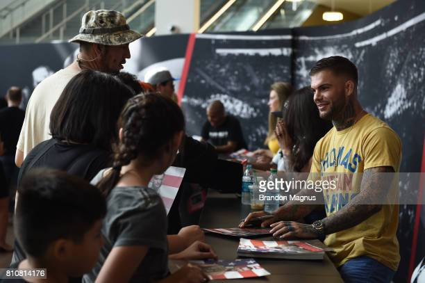 UFC bantamweight champion Cody Garbrandt meets with fans during an autograph session at TMobile Arena on July 8 2017 in Las Vegas Nevada