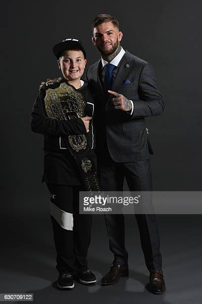 UFC bantamweight champion Cody Garbrandt poses with friend Maddux Maple backstage during the UFC 207 event at TMobile Arena on December 30 2016 in...