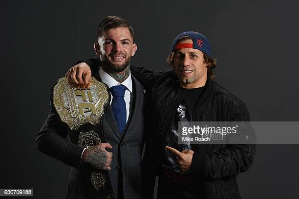 UFC bantamweight champion Cody Garbrandt poses with Urijah Faber backstage during the UFC 207 event at TMobile Arena on December 30 2016 in Las Vegas...