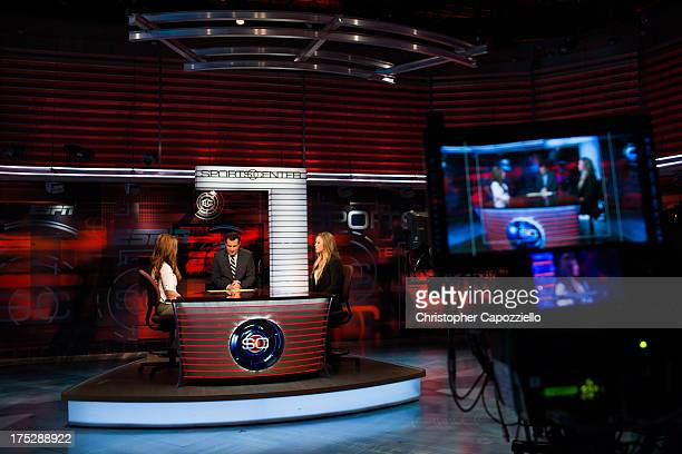 UFC bantamweight champion Ronda Rousey and Miesha Tate are interviewed by Bram Weinstein on Sportscenter at ESPN's headquarters on August 1 2013 in...