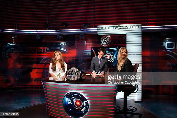 UFC bantamweight champion Ronda Rousey and Miesha Tate are interviewed on Sportscenter at ESPN's headquarters on August 1 2013 in Bristol Connecticut...