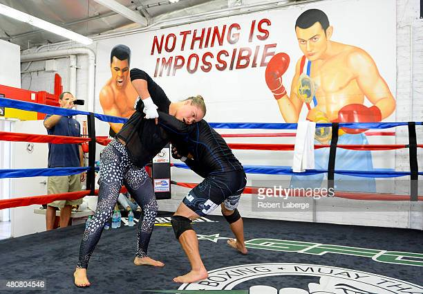 Bantamweight champion Ronda Rousey spars with Justin Flores during a media training session at the Glendale Fight Club on July 15 2015 in Glendale...