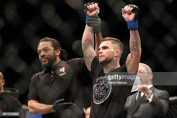 Bantamweight fighter Cody Garbrandt celebrates his victory over Marcus Brimage at the MGM Grand Garden Arena on January 3 2015 in Las Vegas Nevada...