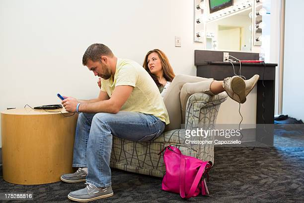 UFC bantamweight fighter Miesha Tate waits with her boyfriend Bryan Caraway also a UFC fighter in the makeup room at ESPN's headquarters on August 1...