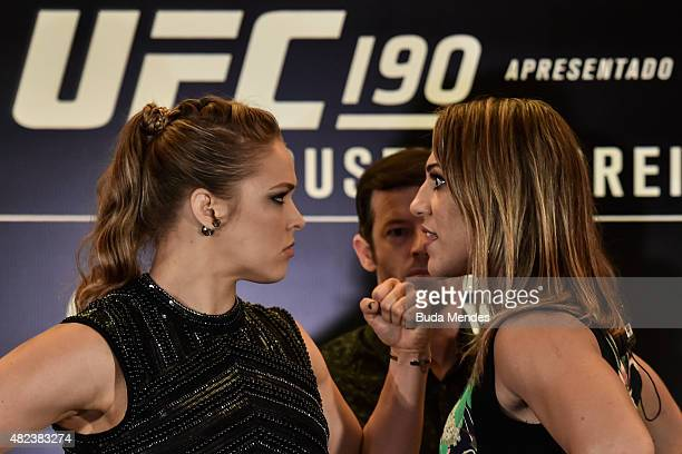 Bantamweight fighters Ronda Rousey of the United States and Bethe Correia of Brazil face off during Ultimate Media Day at Sheraton Hotel on July 30...