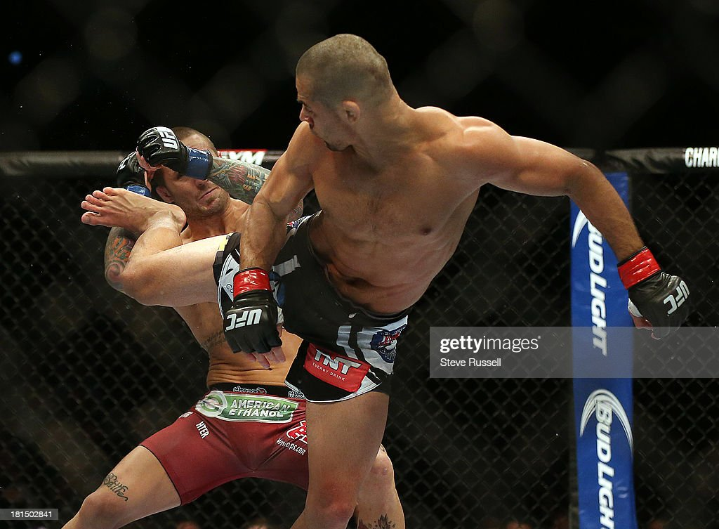 TORONTO, ON- SEPTEMBER 21 - Bantamweight Renan Barão from Brazil retains his interim title with a knock out via spinning back kick to Eddie Wineland from Indiana at UFC 165 at the Air Canada Centre in Toronto, September 21, 2013.