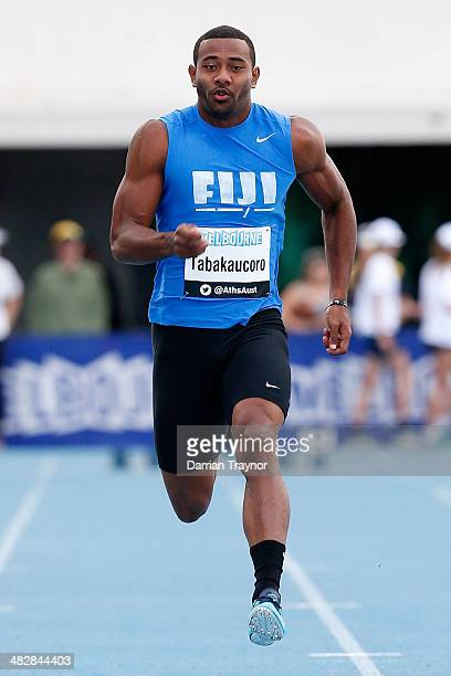 Banuve Tabakaucoro of Fiji runs in the 100m during the 92nd Australian Athletics Championships at Olympic Park on April 3 2014 in Melbourne Australia