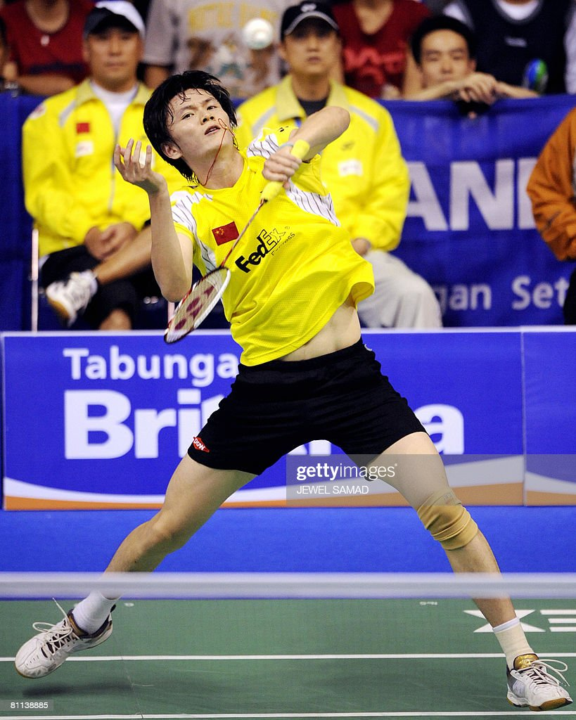 Bao Chunlai of China hits a smash agains