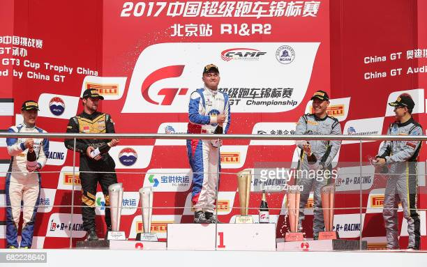 Bao Jinlong Martin Ragginger Xu Jia of China Fang Junyu and Vutthikorn celebrate on the podium after the first round of the 2017 China GT...