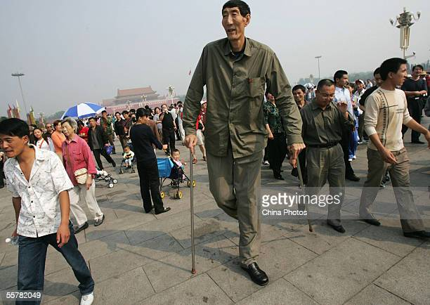 Bao Xishun a Chinese man who measures 2361 meters walks during a sightseeing event at the Tiananmen Square September 27 2005 in Beijing China...