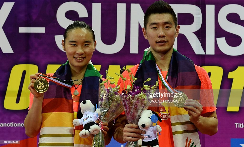 <a gi-track='captionPersonalityLinkClicked' href=/galleries/search?phrase=Bao+Yixin&family=editorial&specificpeople=8308329 ng-click='$event.stopPropagation()'>Bao Yixin</a> (L) and Liu Cheng (R) of China hold their medals after defeating <a gi-track='captionPersonalityLinkClicked' href=/galleries/search?phrase=Joachim+Fischer+Nielsen&family=editorial&specificpeople=5851511 ng-click='$event.stopPropagation()'>Joachim Fischer Nielsen</a> and <a gi-track='captionPersonalityLinkClicked' href=/galleries/search?phrase=Christinna+Pedersen&family=editorial&specificpeople=5933396 ng-click='$event.stopPropagation()'>Christinna Pedersen</a> of Denmark in their mixed doubles badminton final match at the Yonex -Sunrise India Open 2015 at the Siri Fort Sports complex in New Delhi on March 29, 2015.