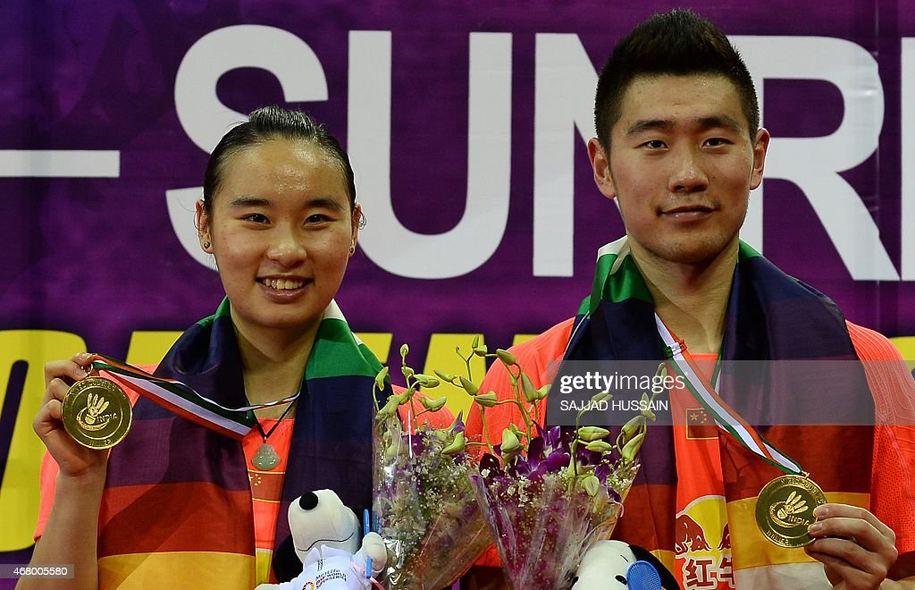 <a gi-track='captionPersonalityLinkClicked' href=/galleries/search?phrase=Bao+Yixin&family=editorial&specificpeople=8308329 ng-click='$event.stopPropagation()'>Bao Yixin</a> (L) and Liu Cheng (R) of China hold their medals after defeating Joachim Fischer Nielsen and Christinna Pedersen of Denmark in their mixed doubles badminton final match at the Yonex -Sunrise India Open 2015 at the Siri Fort Sports complex in New Delhi on March 29, 2015.