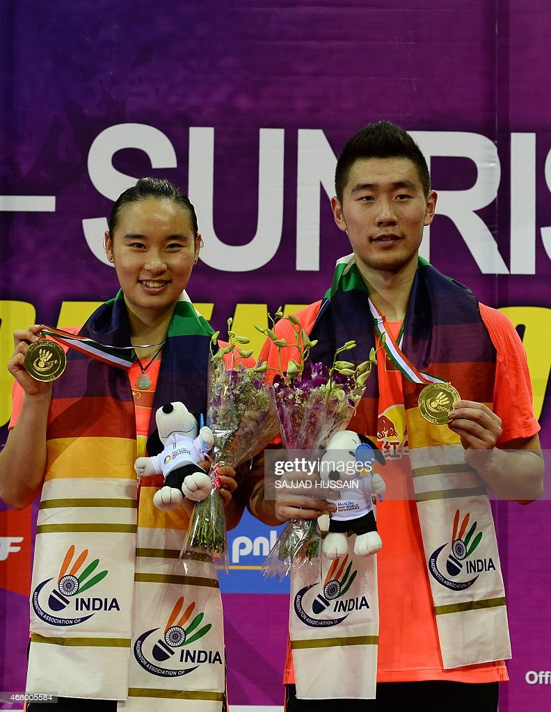 Bao Yixin L and Liu Cheng R of China hold their medals after