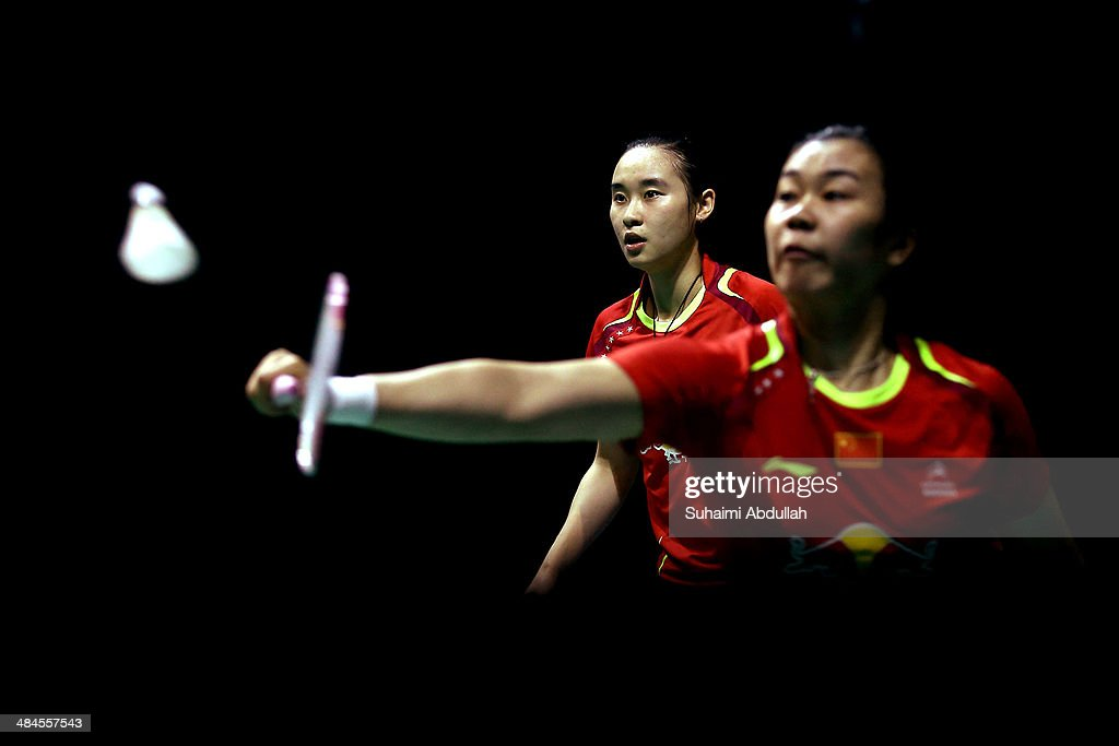 <a gi-track='captionPersonalityLinkClicked' href=/galleries/search?phrase=Bao+Yixin&family=editorial&specificpeople=8308329 ng-click='$event.stopPropagation()'>Bao Yixin</a> and Tang Jinhua of China in action during the women's doubles final of the 2014 Singapore Open at Singapore Indoor Stadium on April 13, 2014 in Singapore.