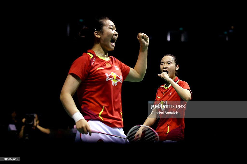 <a gi-track='captionPersonalityLinkClicked' href=/galleries/search?phrase=Bao+Yixin&family=editorial&specificpeople=8308329 ng-click='$event.stopPropagation()'>Bao Yixin</a> and Tang Jinhua of China reacts after winning a point during the women's doubles final of the 2014 Singapore Open at Singapore Indoor Stadium on April 13, 2014 in Singapore.