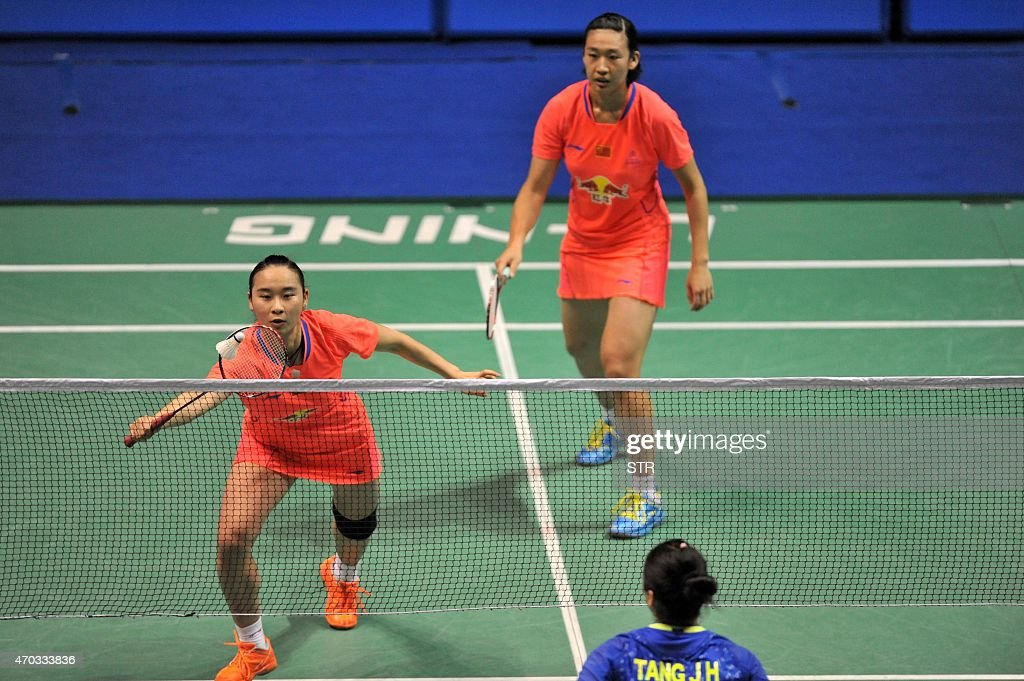 <a gi-track='captionPersonalityLinkClicked' href=/galleries/search?phrase=Bao+Yixin&family=editorial&specificpeople=8308329 ng-click='$event.stopPropagation()'>Bao Yixin</a> (L) and Yang Yuanting of China hit a return against Tang Jinhua and Zhong Qianxin of China during their women's doubles final at the BWF China Masters Grand Prix Gold badminton tournament at the Olympic Sports Center Xincheng Gymnasium in Changzhou, in eastern China's Jiangsu province on April 19, 2015. CHINA