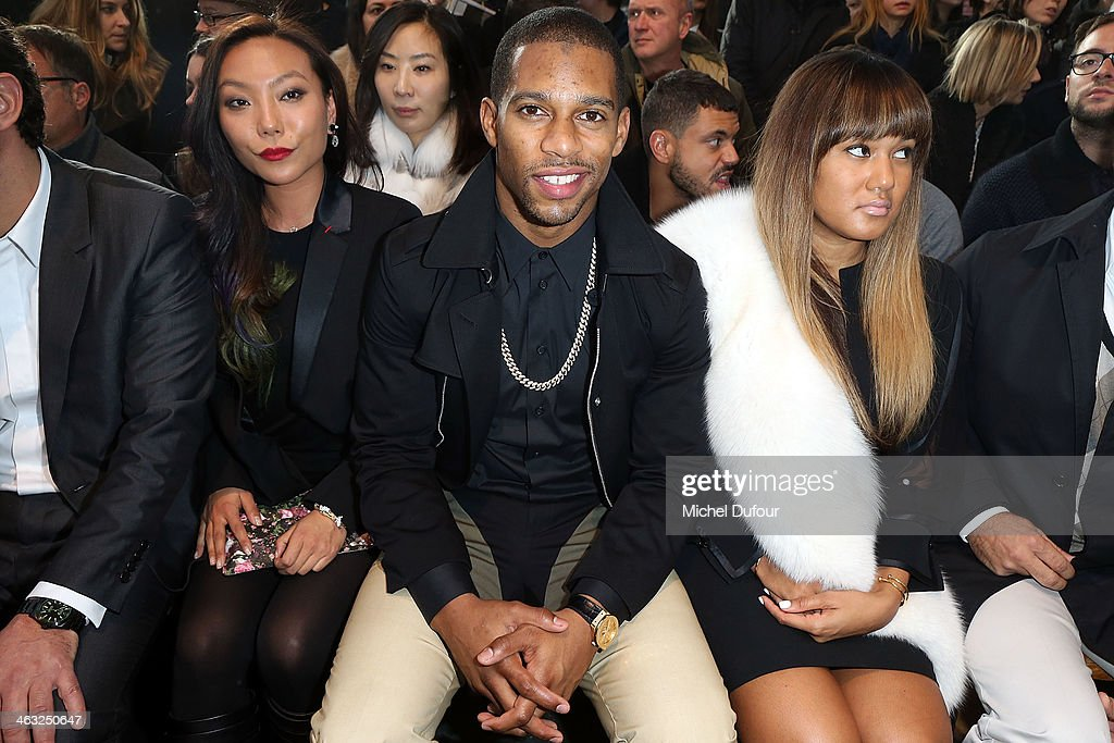 Baobao Wan, Elaina Watley and <a gi-track='captionPersonalityLinkClicked' href=/galleries/search?phrase=Victor+Cruz+-+American+Football+Player&family=editorial&specificpeople=8736842 ng-click='$event.stopPropagation()'>Victor Cruz</a> attend the Givenchy Menswear Fall/Winter 2014-2015 Show as part of Paris Fashion Week on January 17, 2014 in Paris, France.