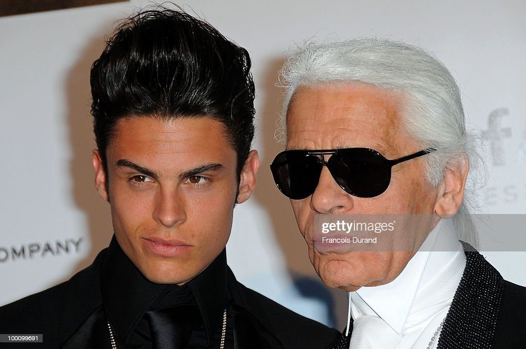 Baptiste Giabiconi and Karl Lagerfeld arrive at amfAR's Cinema Against AIDS 2010 benefit gala at the Hotel du Cap on May 20, 2010 in Antibes, France.