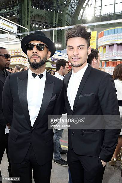 Baptiste Giabiconi and Swizz Beatz attend the Chanel show as part of the Paris Fashion Week Womenswear Fall/Winter 20142015 on March 4 2014 in Paris...