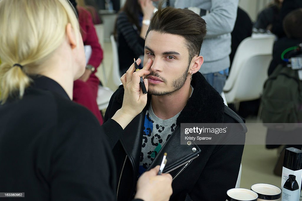 <a gi-track='captionPersonalityLinkClicked' href=/galleries/search?phrase=Baptiste+Giabiconi&family=editorial&specificpeople=5770755 ng-click='$event.stopPropagation()'>Baptiste Giabiconi</a> prepares backstage before the Chanel Fall/Winter 2013/14 Ready-to-Wear show as part of Paris Fashion Week at Grand Palais on March 5, 2013 in Paris, France.