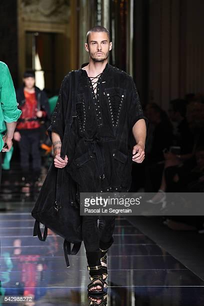 Baptiste Giabiconi walks the runway during the Balmain Menswear Spring/Summer 2017 show as part of Paris Fashion Week on June 25 2016 in Paris France
