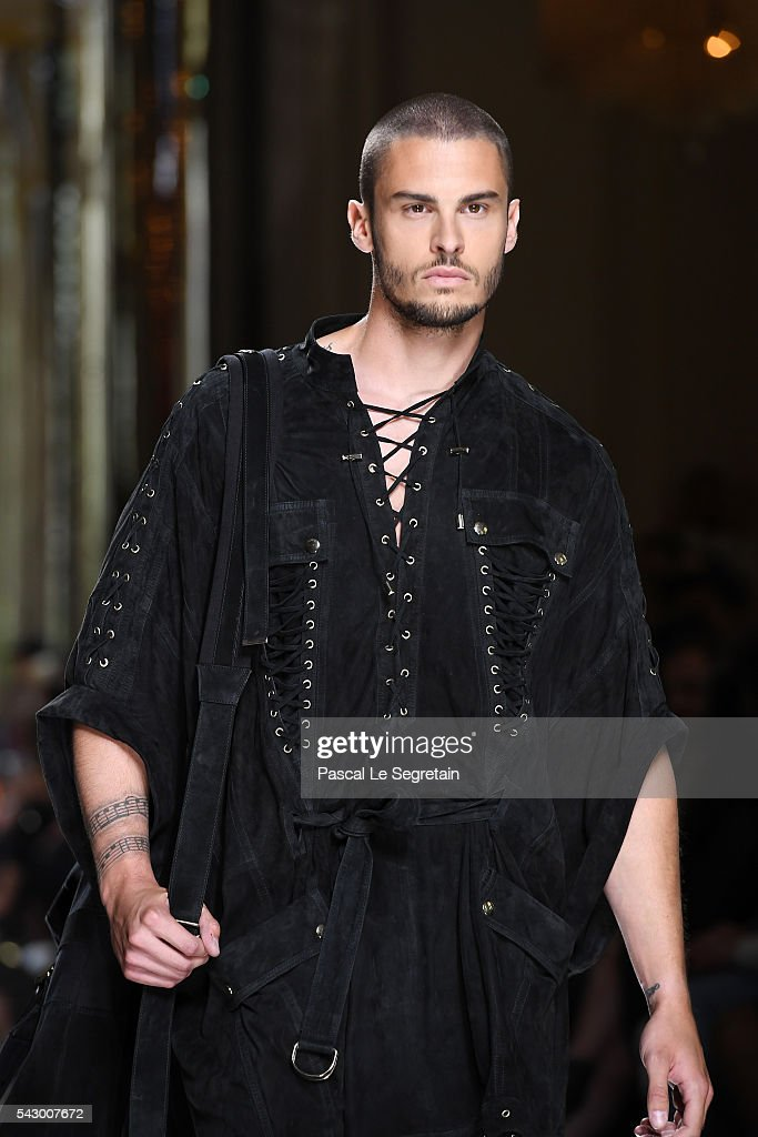 Baptiste Giabiconi walks the runway during the Balmain Menswear Spring/Summer 2017 show as part of Paris Fashion Week on June 25, 2016 in Paris, France.