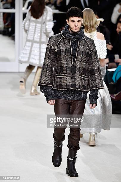 Baptiste Giabiconi walks the runway during the Chanel show as part of the Paris Fashion Week Womenswear Fall/Winter 2016/2017 on March 8 2016 in...