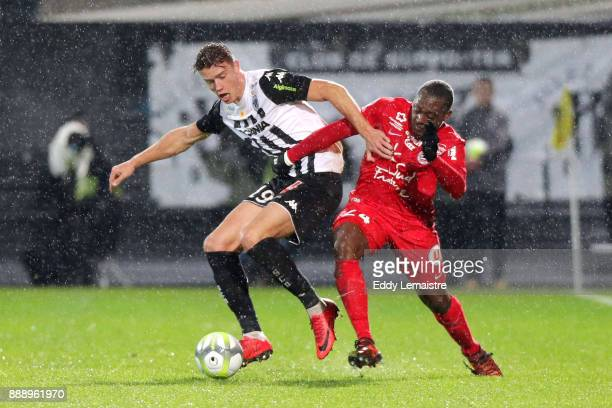 Baptiste Guillaume of Angers and Jerome Roussillon of Montpellier during the Ligue 1 match between Angers SCO and Montpellier Herault SC at Stade...
