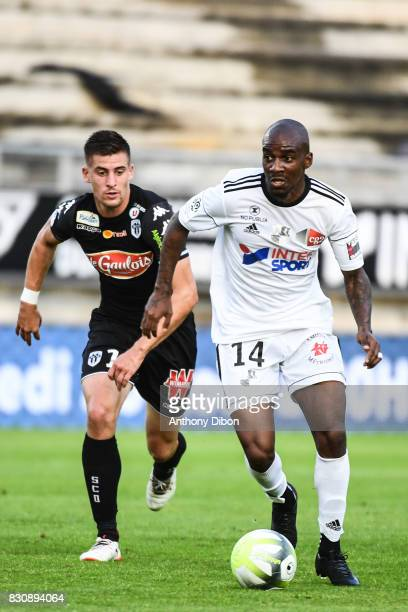 Baptiste Santamaria of Angers and Gael Kakuta of Amiens during the Ligue 1 match between Amiens SC and Angers SCO at Stade de la Licorne on August 12...