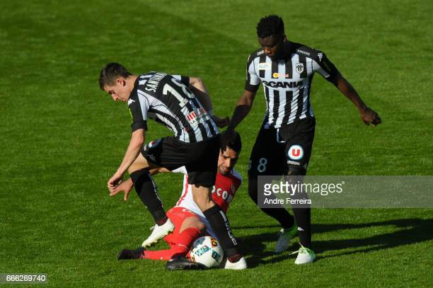 Baptiste Santamaria of Angers and Radamel Falcao of Monaco and Ismael Traore of Angers during the Ligue 1 match between SCO Angers and AS Monaco on...