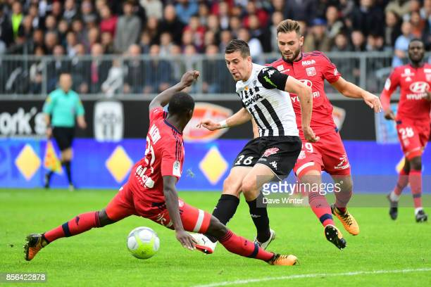 Baptiste Santamaria of Angersslips the ball past Ferland Mendy of Lyon during the Ligue 1 match between Angers SCO and Olympique Lyonnais at Stade...