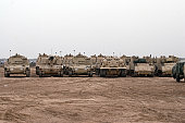 Baqubah, Iraq - A selection of M992 C.A.T or Carrier Ammunition Tracked vehicles line up during a deployment with some M113 and M109 vehicles at Camp Warhorse.
