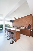 Bar counter and bottles with high white ceiling