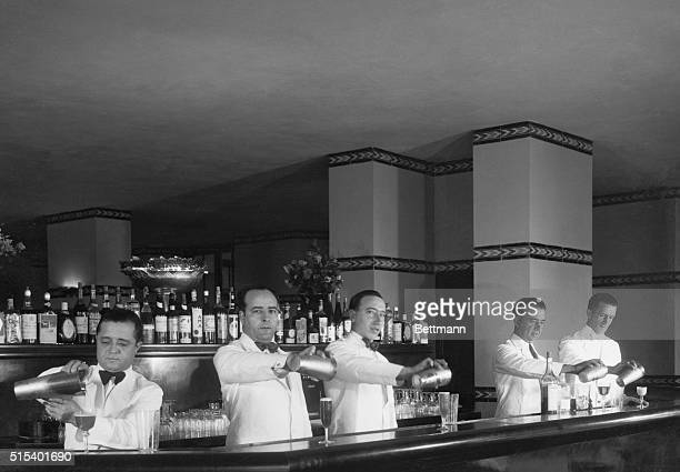 Bar Experts Seek Championship The merry music of clinking ice in frosted shakers tells the story of these five Havana Cuba bartenders who are...
