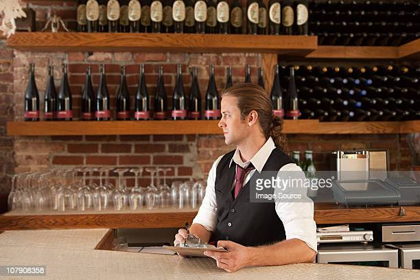 Bar manager looking at paperwork