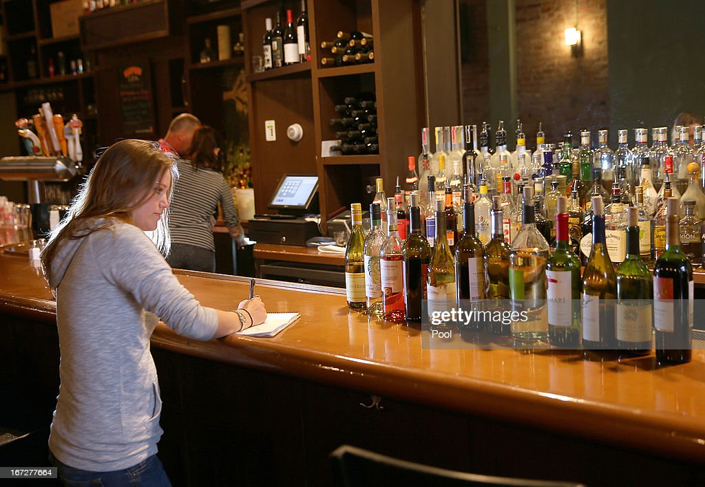 Bar manager Maggie Brown takes inventory of bottles of wine opened a week ago at Globe Restaurant on Boylston St on April 23, 2013 in Boston, Massachusetts. The city conducted a final cleanup of Boylston Street and started opening the street to residents and business owners.