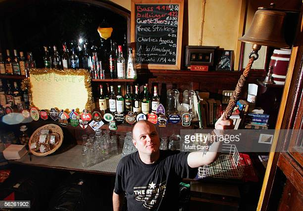 Bar manager Paul Waters rings the bell at 11pm to signal 'time at the bar' in a traditional public house the Star Inn on November 22 2005 in Bath...