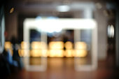 The blurred and abstract lighted interior of a bar.