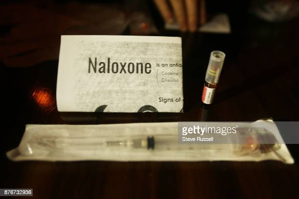 TORONTO ON NOVEMBER 18 bar owner Carmen Elle of Less Bar with her Naloxone kit The Canadian Mental Health Association has prepared a toolkit for...